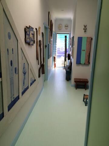 Indoor hallway. Polished floors. Sock feet inside the house please.