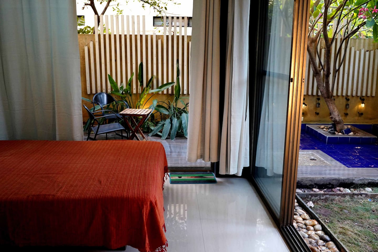 Room with a garden and pond. The room is a private space suited for a peaceful and comfortable stay. Also good for working professionals. It's the apt place to unwind after a day of touristy activities. Or one can spend an entire rainy day here too!