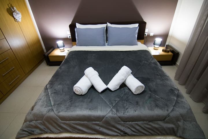"""Top quality bedsheets in the modern and  stylish Bedroom Nefeli with a TV """"32"""" and and air- condition!"""