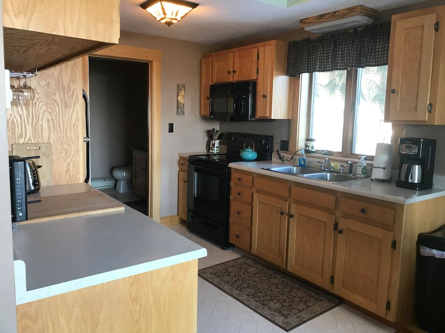Well stocked kitchen with 1st floor bath off from kitchen - open floor plan