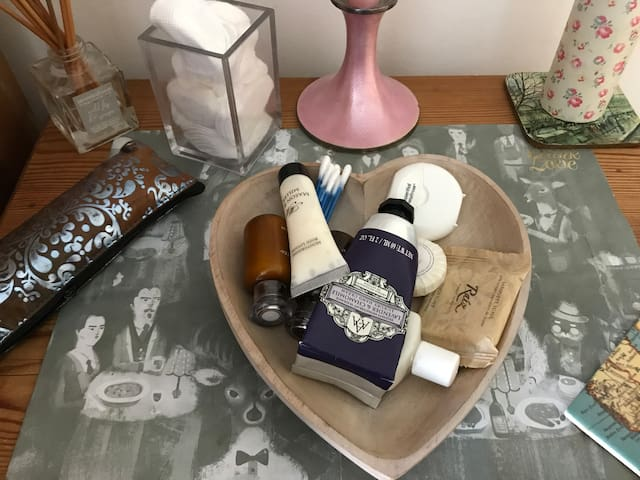 Toiletries and things you might have forgotten like bottle opener, or toothbrush, shampoos and conditioners organic