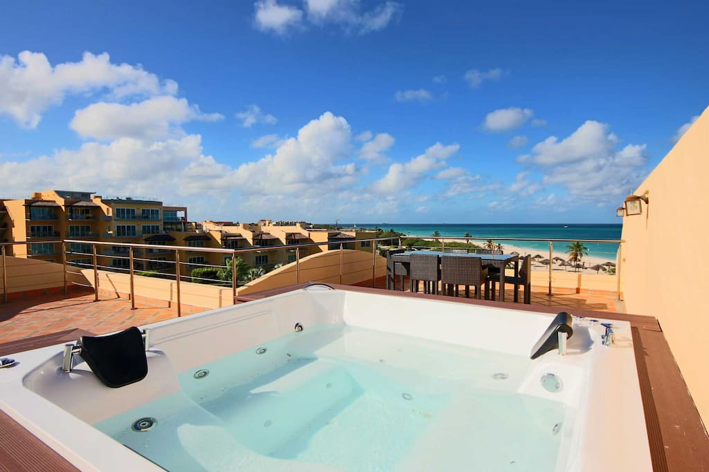 Outdoor hot tub and a spectacular, panoramic ocean view!