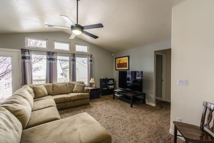"""Living room w/ 65"""" 4K TV and Xbox One"""