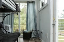 Bunk/Futon in upper level. Private entrance with Pocket Door