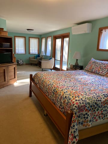 Lovely, spacious bedroom with reading nook and slider to patio and backyard. Enjoy a book or board game in your downtime. Table, chairs, and umbrella on the patio for outdoor relaxation.