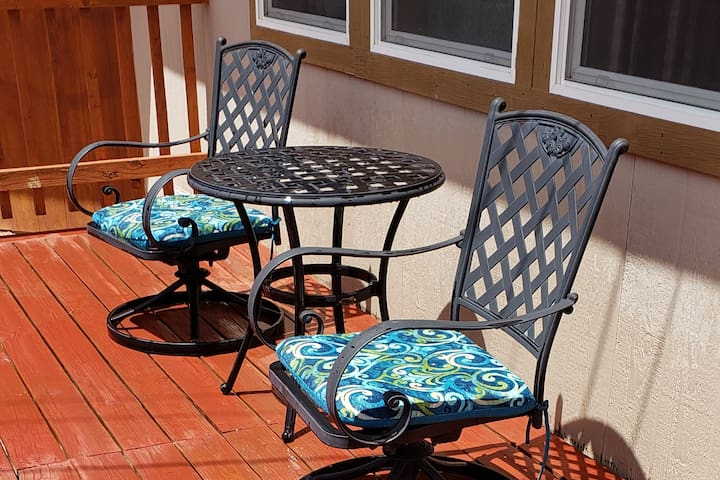 Deck with chairs and table surrounding private room
