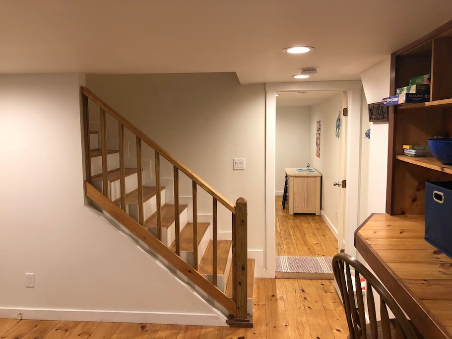 Stairs down to the basement. Common area to the right. Bedroom to the left.