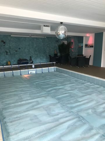 Swimming pool with seating area at the back and disco ball!