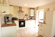 Open plan kitchen with all the essentials you'll need during your stay.