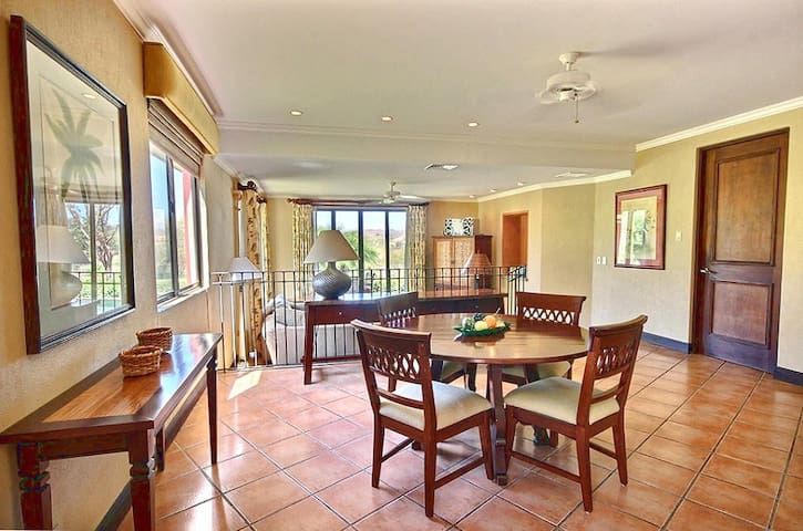 Spacious dining area with elegant table for 4.