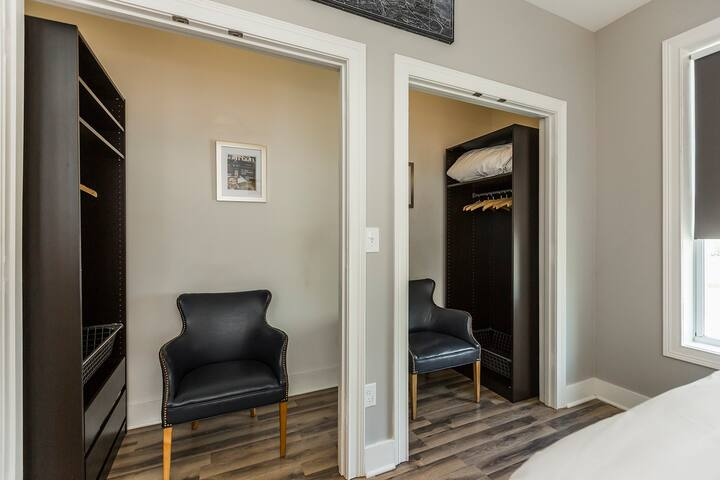 The master bedroom features his and her walk-in closets