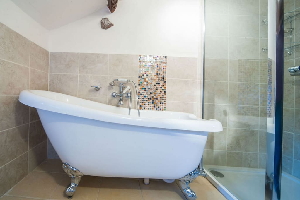 Brand new bathroom with slipper bath and shower unit