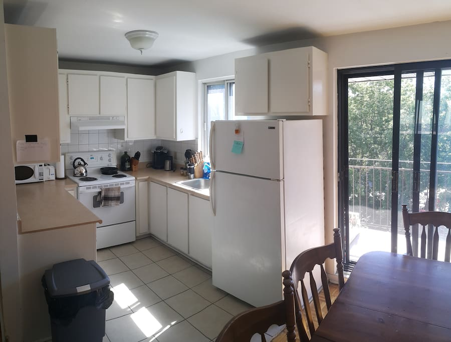 Large clean kitchen with ample counter space. Includes toaster, microwave, and coffee machine (capsules not included).