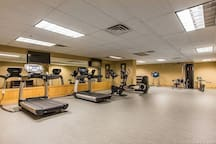 Full gym complete with treadmills, weight system, stationary bike and more.