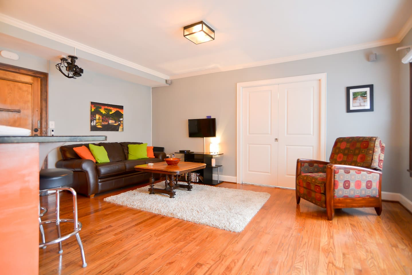 Comfortable living area with open kitchen. Pocket doors lead to master bedroom