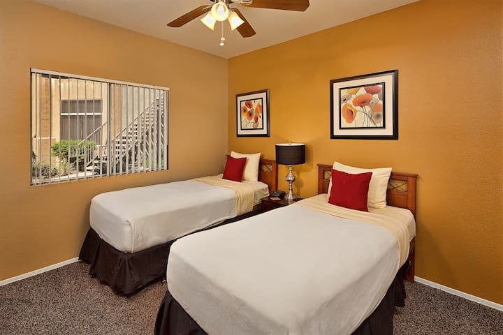 Second bedroom with extra-long twin beds and large walk-in closet.