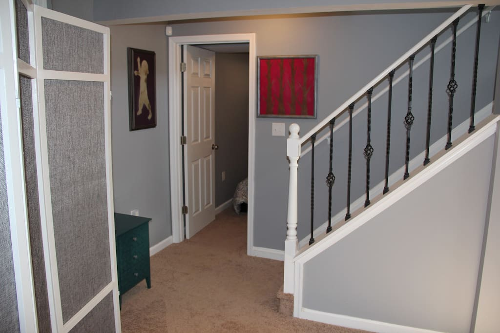 The door on the left is a cozy bedroom with a large closet and lockable door.