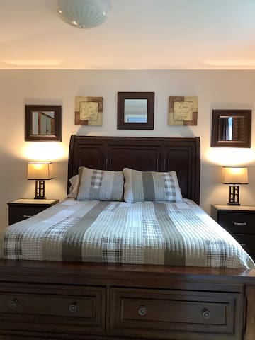 One bedroom with queen size memory foam mattress with extra pillows and blankets.