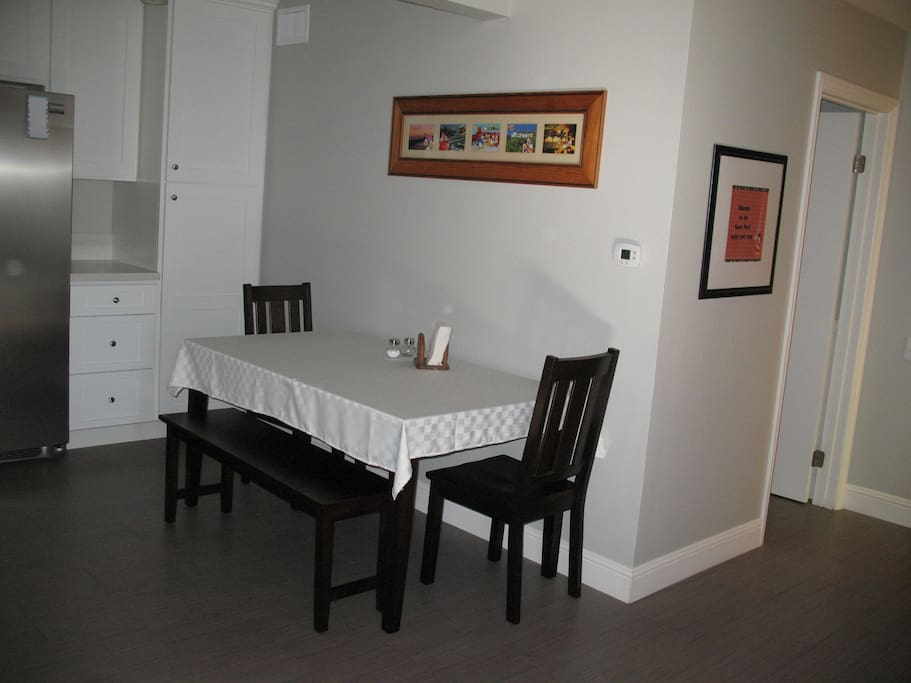 Dining area with 2 chairs and 2 benches