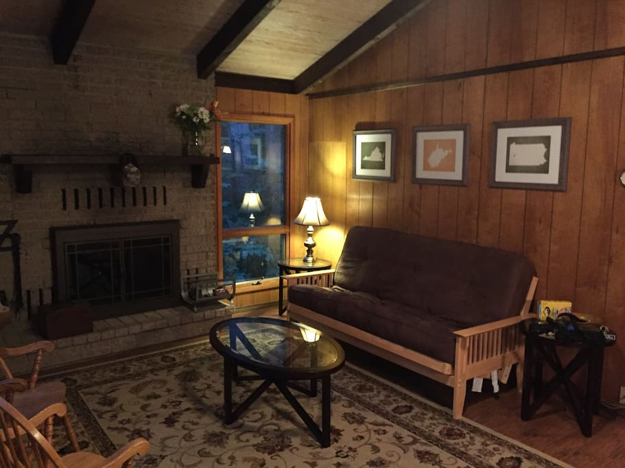 Living room with fire place and futon