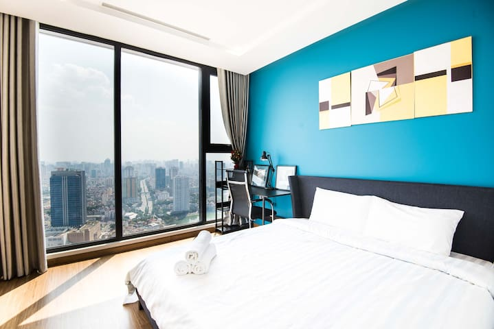 Big bedroom with separate toilet inside and has the best view of Hanoi