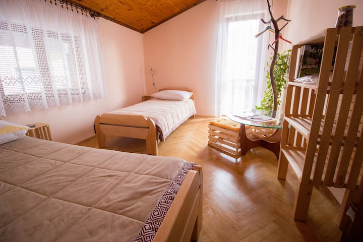 A room with 2 single beds, fresh bed linen, herbal pillows and wooden crates