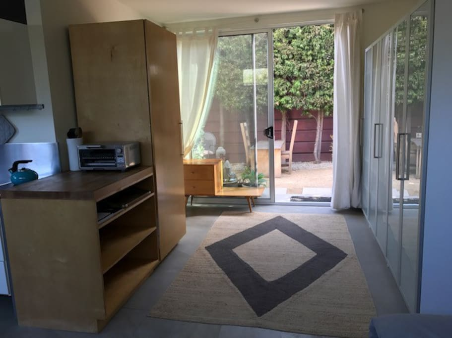 Lots of Closet and storage space. Large glass doors to garden.