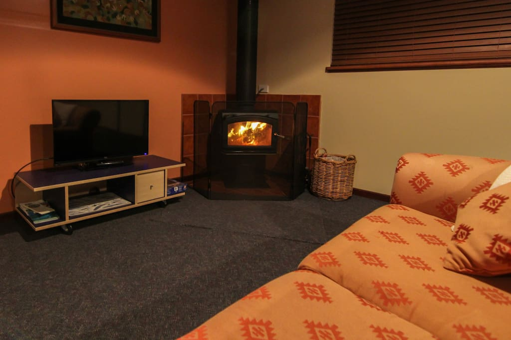 The lounge  is a comfortable space year round and is equipped with a cosy wood fire for the cooler months.