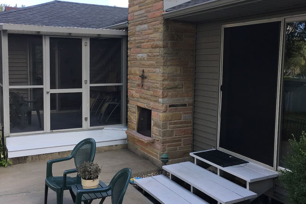Riverside screened in deck and outdoor fireplace and good size gas grill