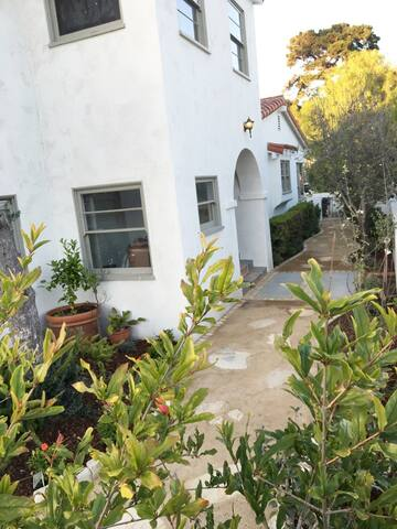 Fruit trees in rear garden with view of private entrance to mother in law quarters