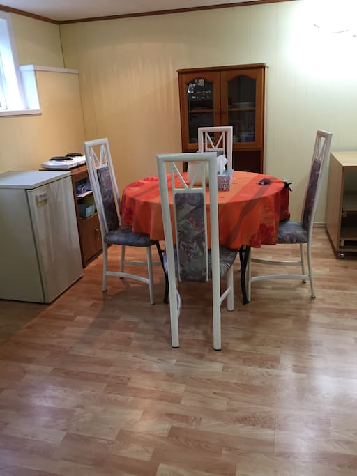 A microwave, refrigerator, dinning table, coffee maker with free coffee and tea