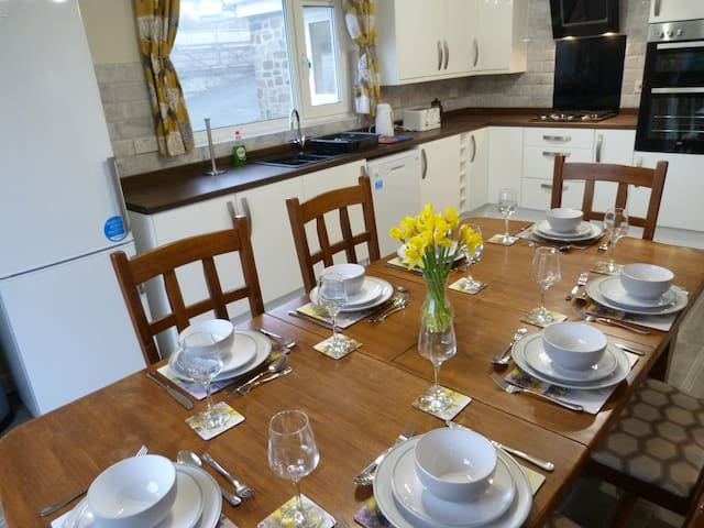 Kitchen table seats 8 people easily and childs high chair can be provided.