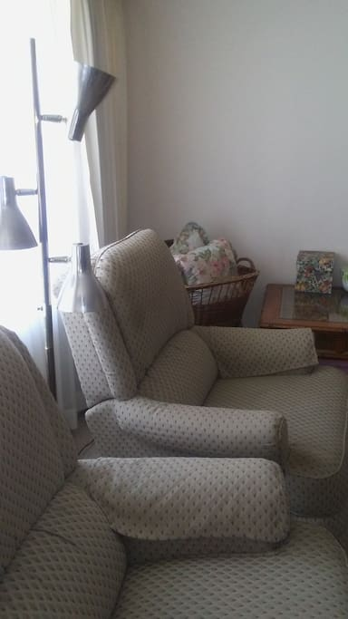 There are two rocker recliners in the living room as well as the couch seen in the previous photo.