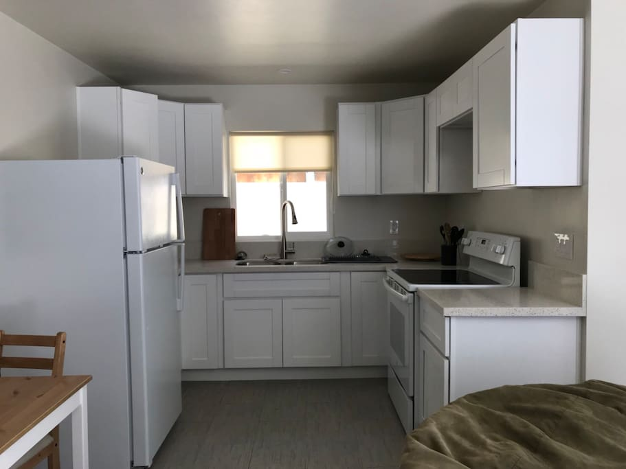 Full kitchen- refrigerator, stove , oven, microwave, sink. Dishes for 4 and cooking utensils.