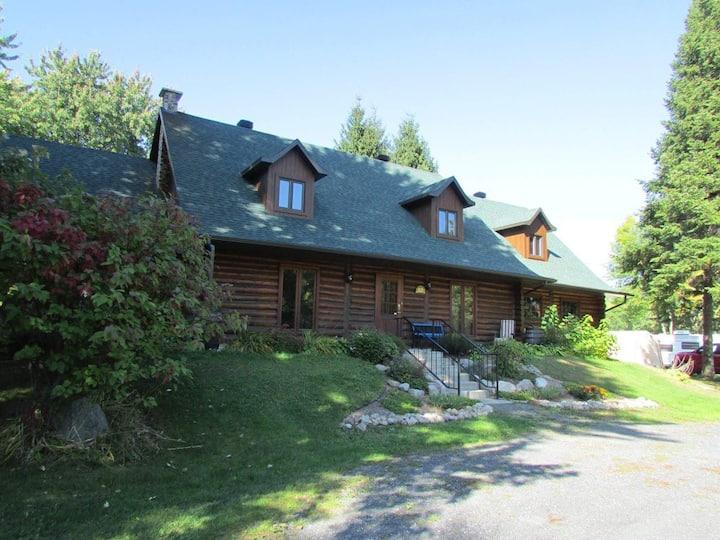 Logement dans une magnifique maison en bois rond