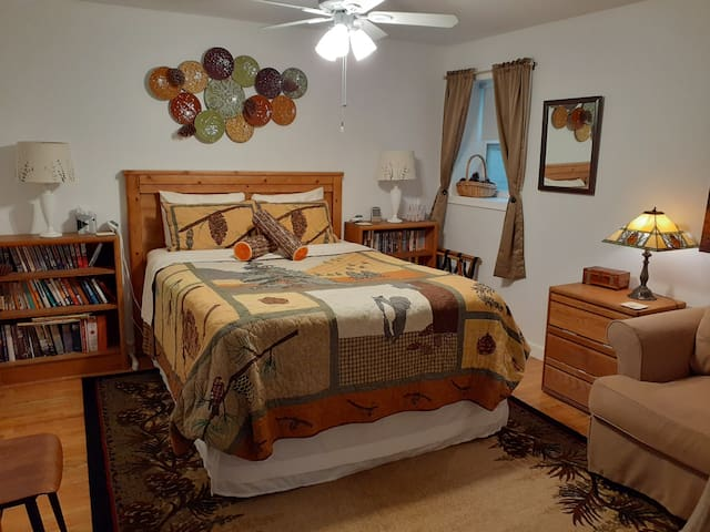 """The """"Pine Cone Room"""" with your comfy Queen bed...which has an electric heated mattress pad for your optional use. There's a ceiling fan."""