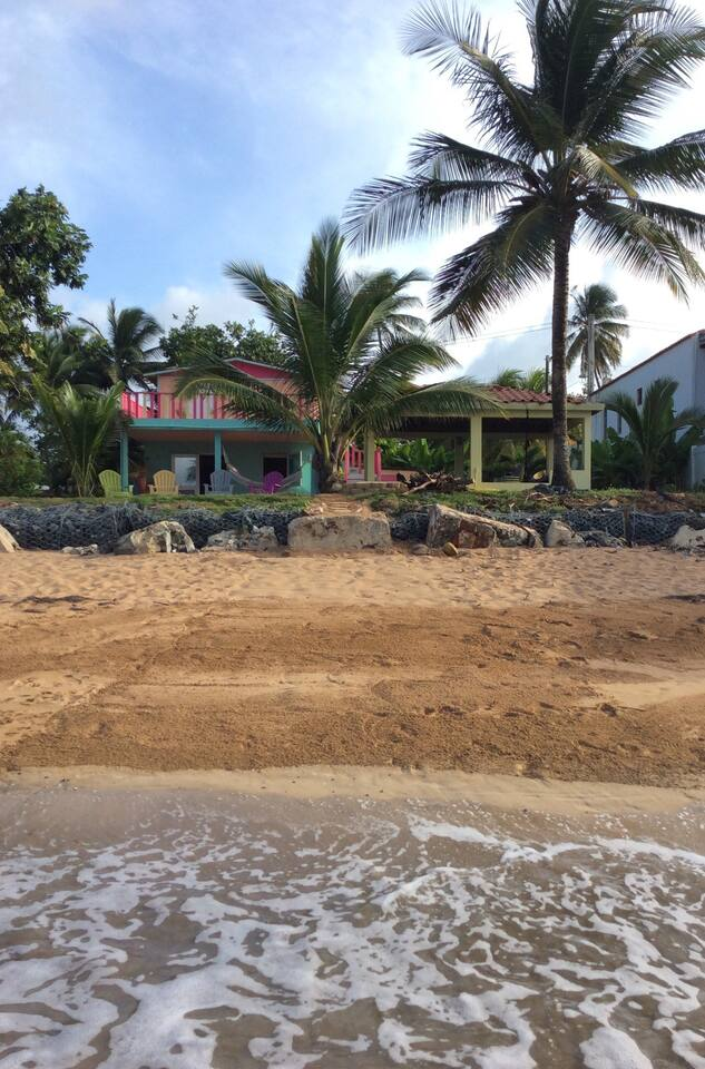 View of the house form the ocean, visit Mar y Miel on social media. We look like this even after hurricane Maria hit. We didn't lose palm trees, the rainforest protected our bay. We got lucky!
