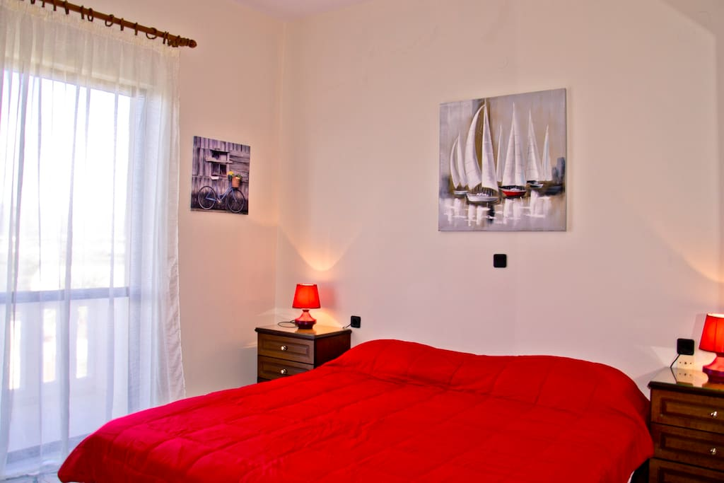 Bedroom with double bed and sea view terrace