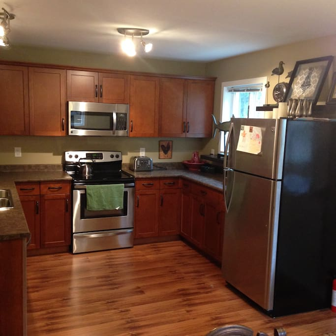 The kitchen includes, fridge, range, microwave, coffee maker, and a dish washer.
