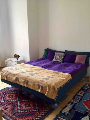 Bedroom 1 with extra comfortable bed, wooden floors, high ceilings and lots of light. Ask which one of the two bedrooms is available for your stay.