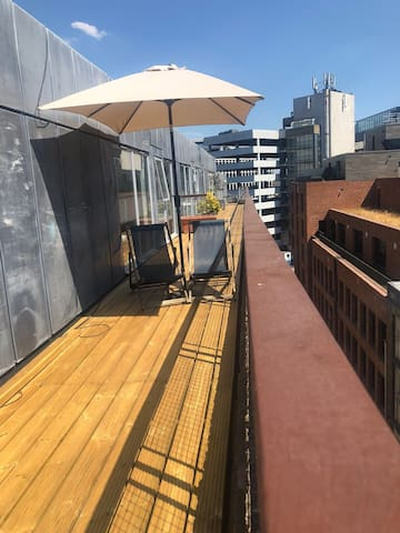 Semi private terrace overlooking the city of London's dramatic skyline — finance skyscrapers. In addition to your private balcony overlooking shoreditch, the creative, start- up, cultural, nightlife epicentre of London.