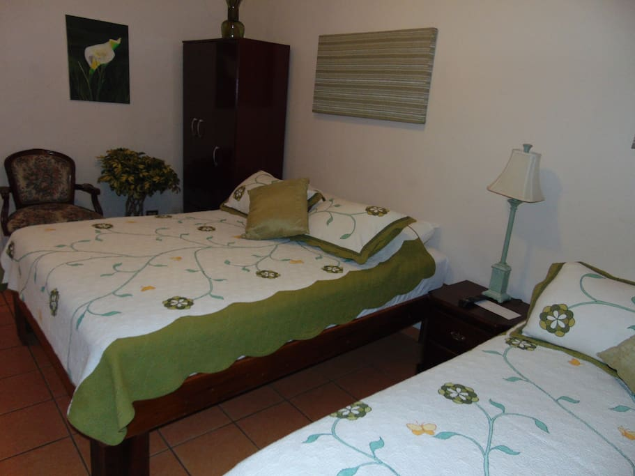 Standard Room. Accomodates 2 people. Has a Flatscreen color TV, private bathroom, closet space, and Airconditioning.