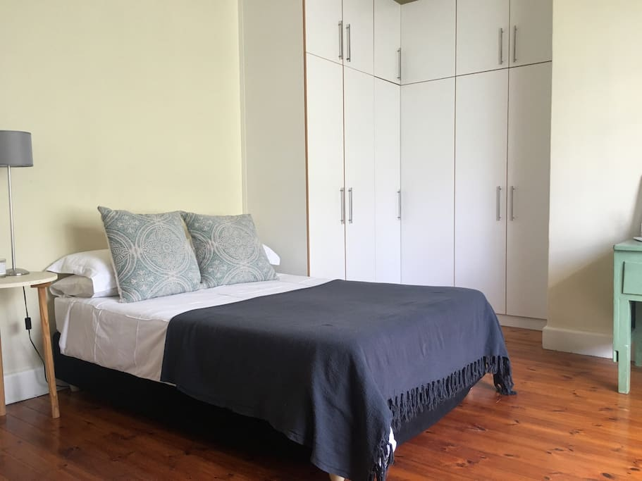Very spacious bedroom, loads of cupboard space, high ceilings and gorgeous wooden floors.
