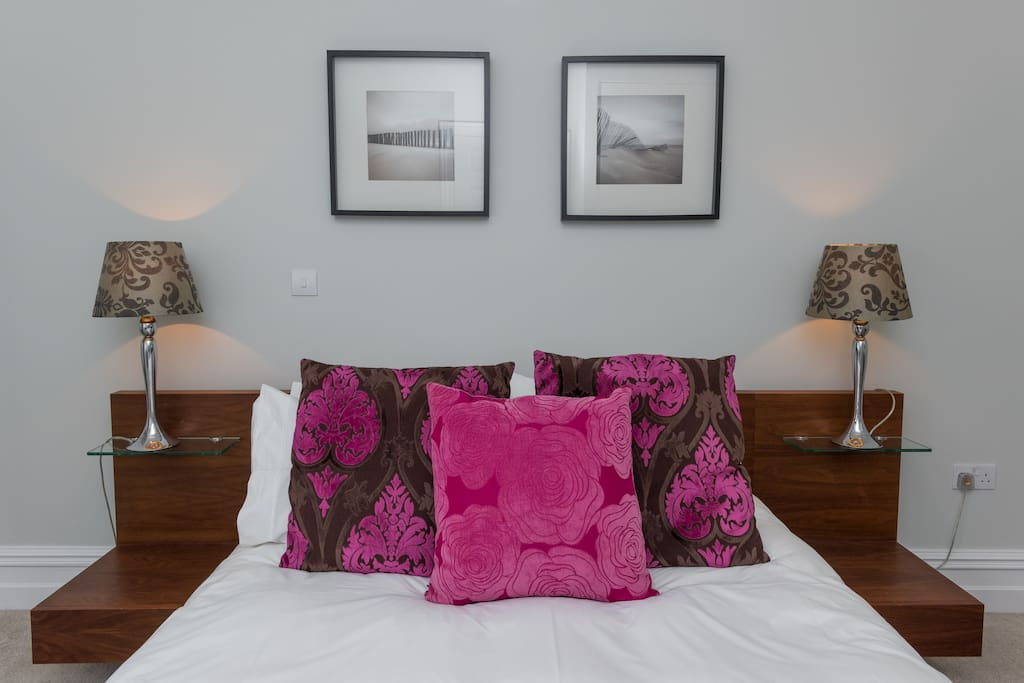 King size bed with scatter cushions