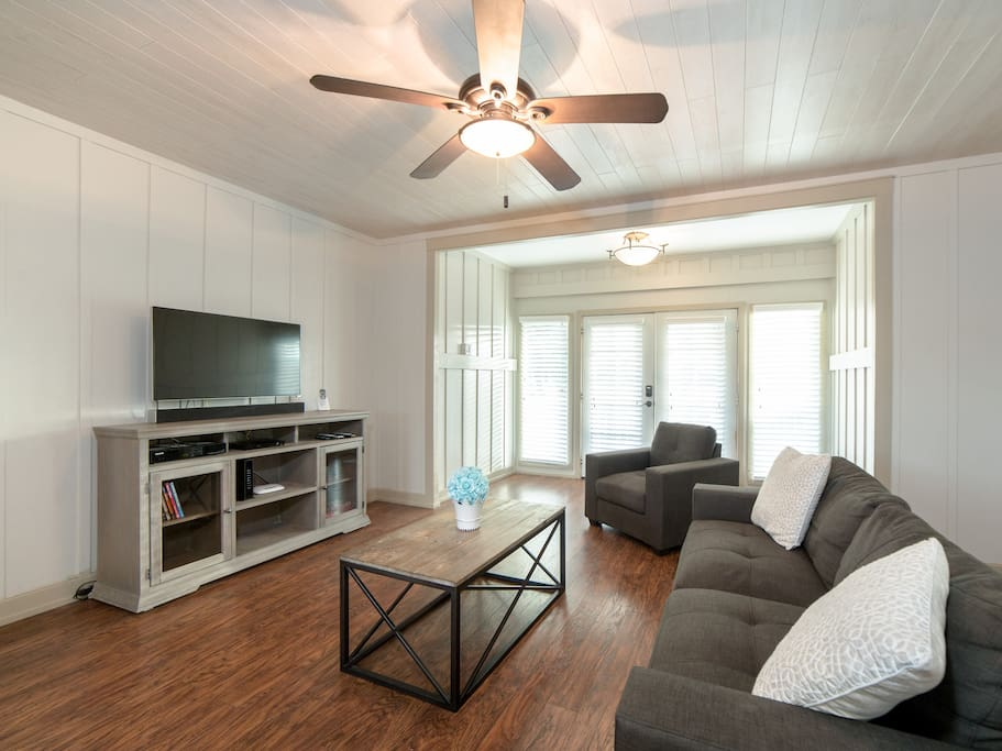 "Inviting living room with 38"" cable TV, DVD and sound bar."