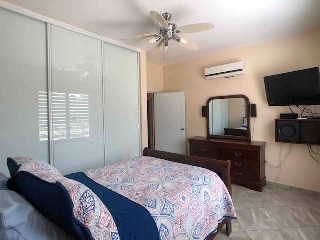 Bedroom equipped with a full size bed, ceiling fan, air conditioning, 32in TV with a DVD Player