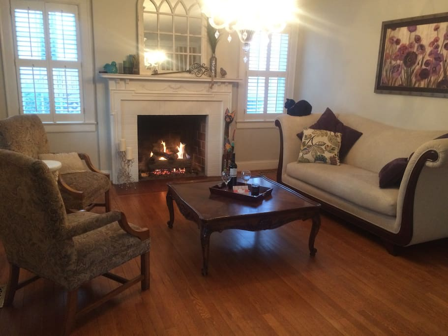 Parlor with gas fireplace, which you are welcome to use. The black cat is not included.