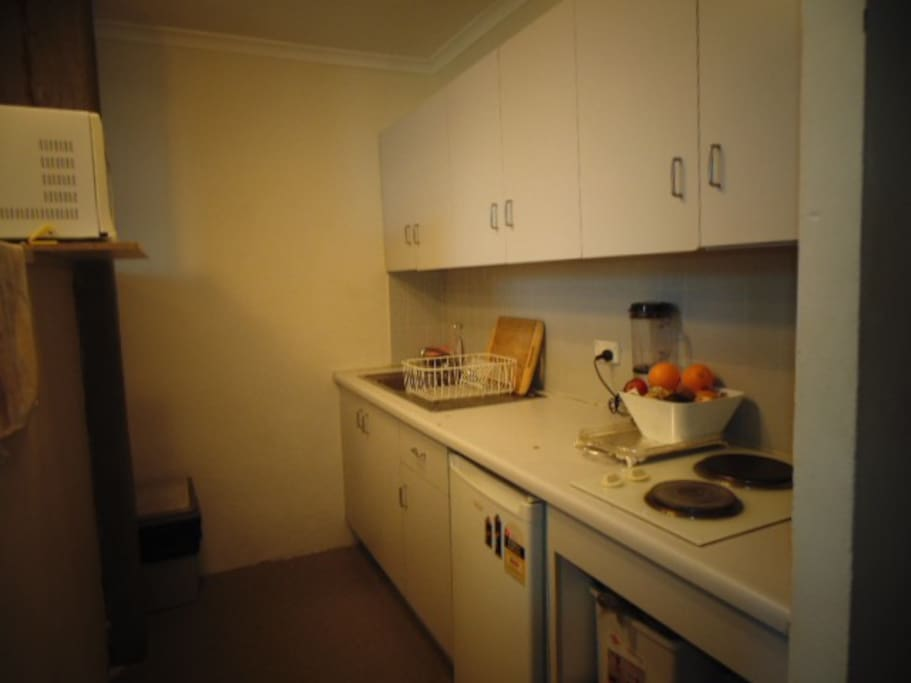 galley style kitchen with electric stove, microwave, decent cutting area