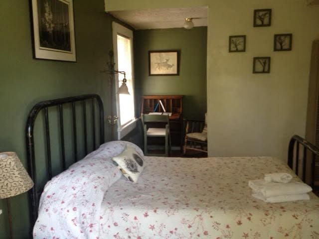 Bedroom and writing desk by window