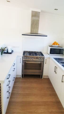 Gas cooktop with electric oven.  Microwave and Fridge/Freezer.  All your essentials including tea, coffee, hot chocolate, sugar & milk.